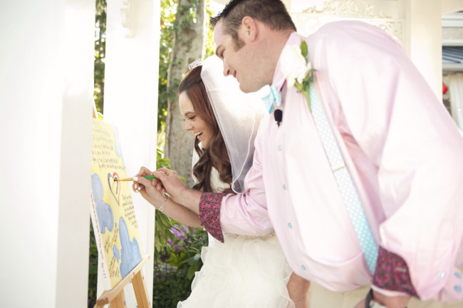 bride and groom painting a heart