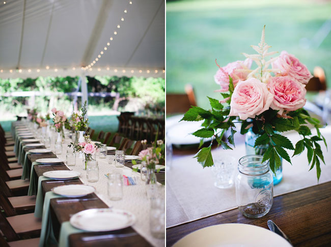 wedding reception under white tent with pink rose table centerpeice