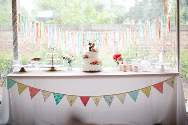 dessert table with colorful bunting banner
