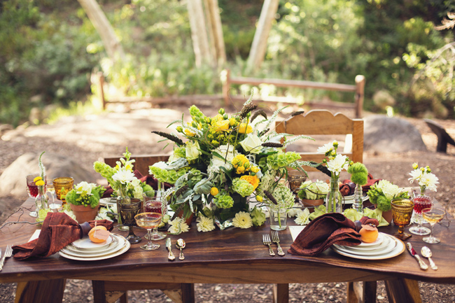 rustic styled shoot table made out of natural wood and gold rimmed china