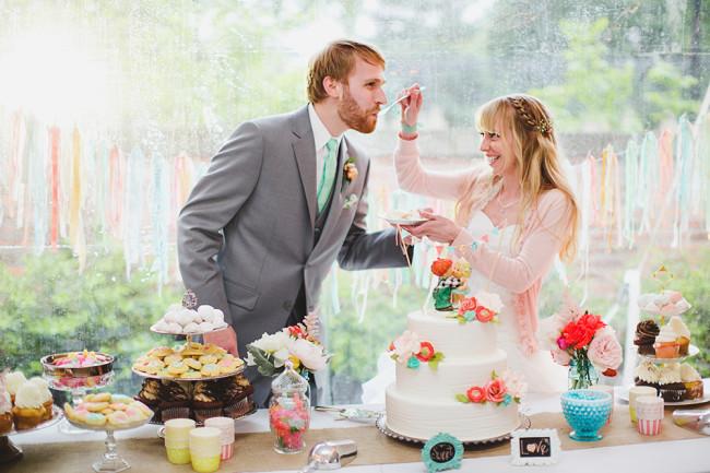 Bride feeding groom some cake