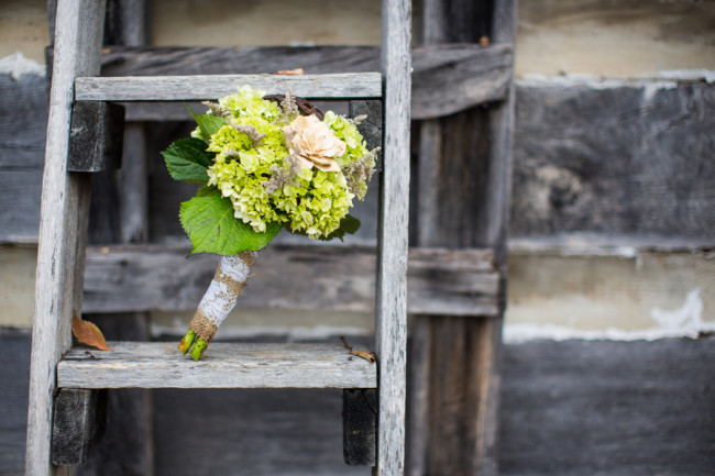 Wedding bouquet resting on wooden staircase