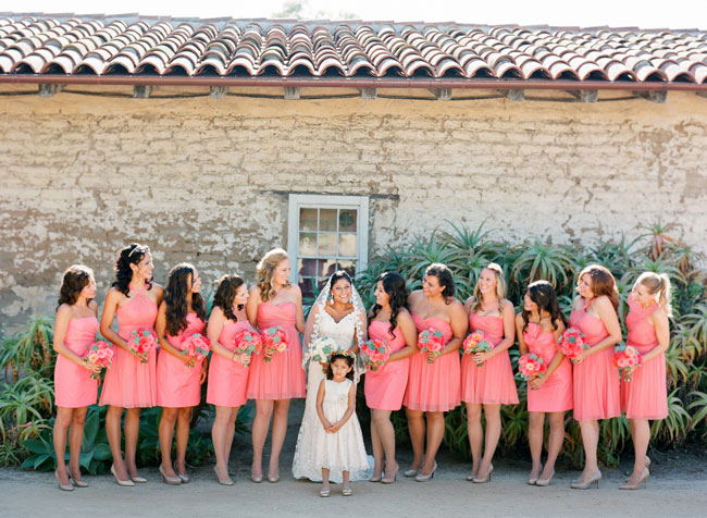 bride and pink bridesmaids standing in a row
