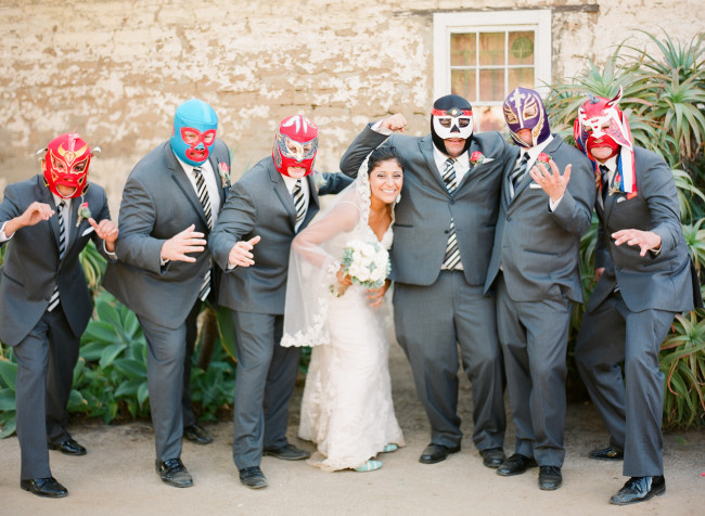 groomsmen wearing luchador themed masks, bride in the middle