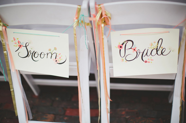 Bride and groom's chairs with signs on the back
