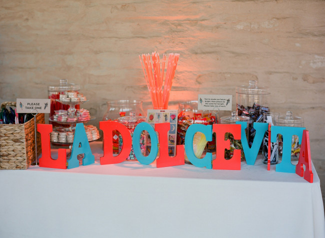 "large colored letters on table that say, ""La Dolce Vita"""