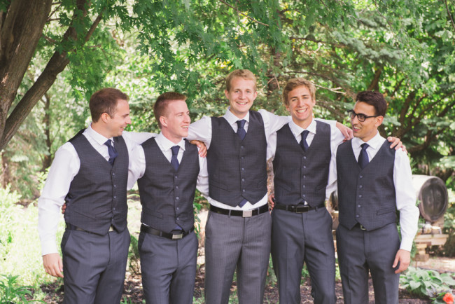 groom and groomsmen sharing a laugh on the big day