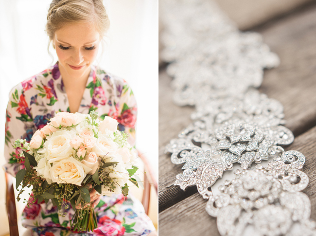 bride in her robe admiring her bouquet; silve sash for her dress