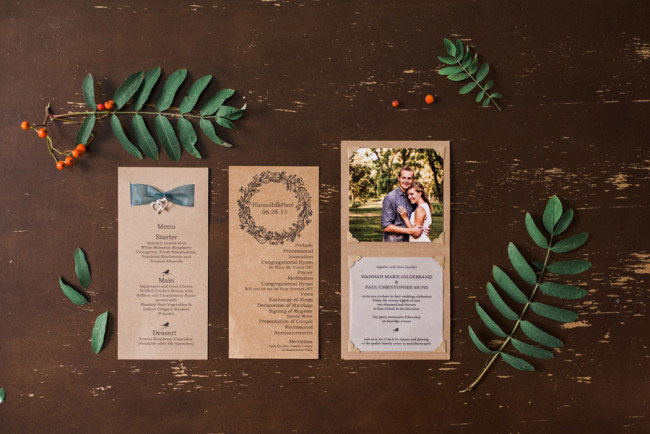 woodsy wedding stationary among leaves: dinner menu, wedding program, wedding invitation with picture