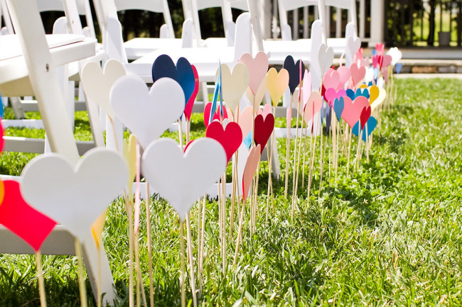 Colorful hearts on a stick line the wedding ceremony aisle at Nesselrod on the New River