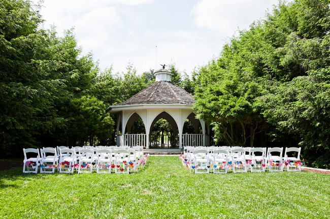 Nesselrod outdoor wedding gazebo with white chairs on the lawn