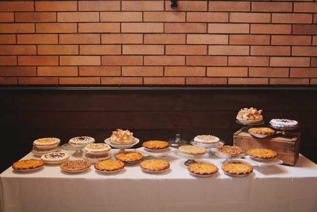 dessert table filled with pies