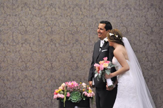 indoor wedding ceremony photo of bride and groom smiling