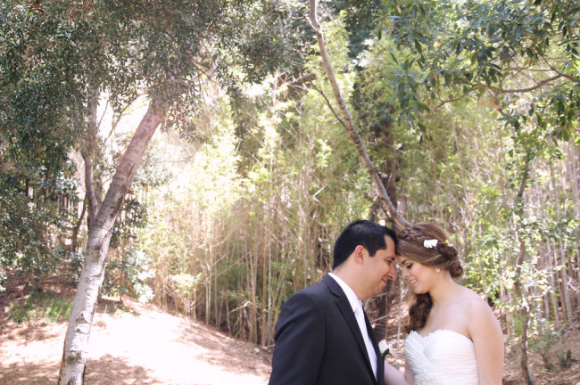 bride and groom take a moment in the woods