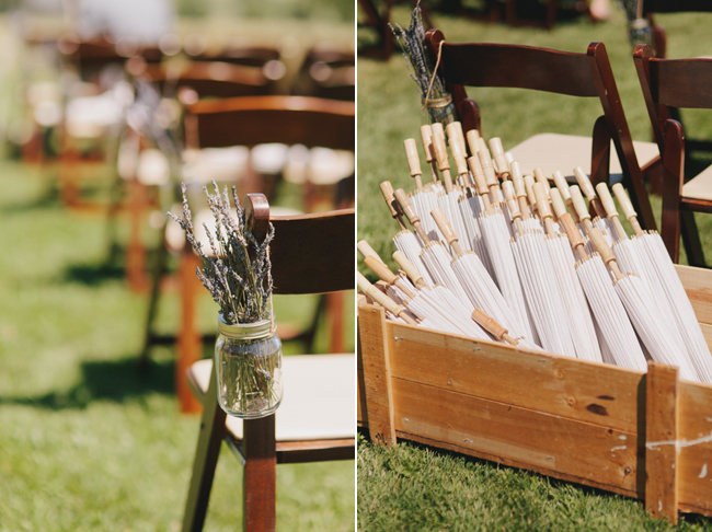 crate filled with parasols; mason jar with lavender aisle marker