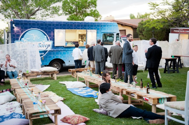 Food truck at a wedding in Los Angeles, with tables and pillows on front lawn