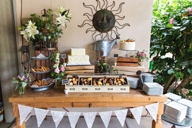 table with wood crates holding desserts