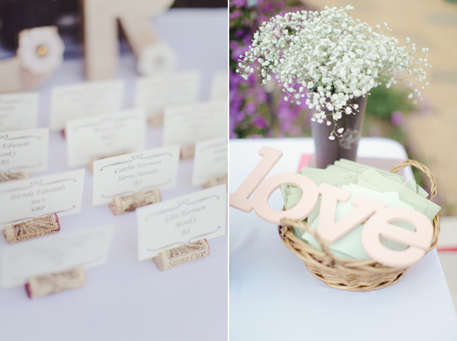 table seating cards in wine cork holders; baby's breath flowers