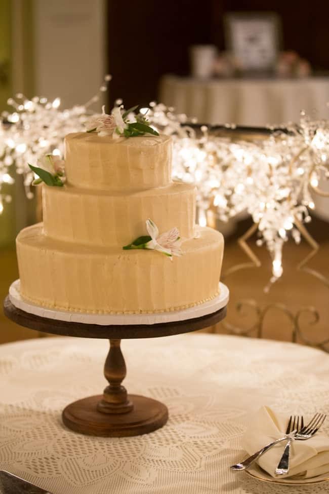 three-tier wedding cake on stand
