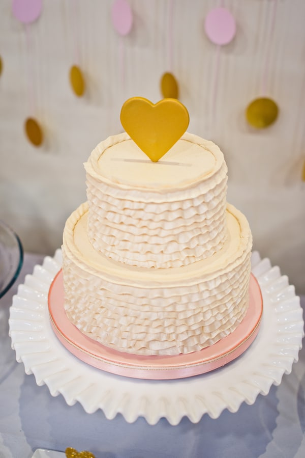 Wedding cake with large gold heart cake topper