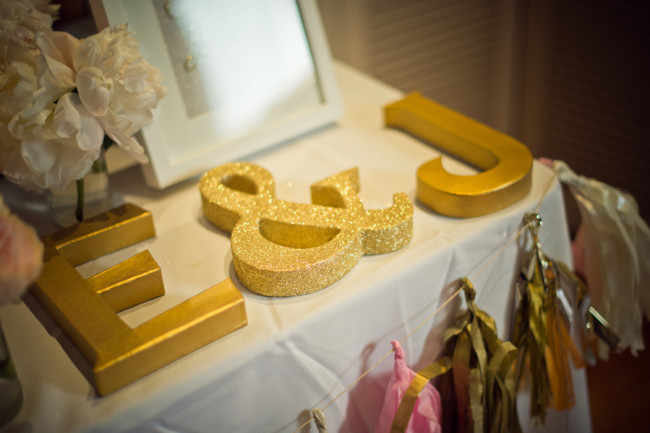 giant gold letters on table
