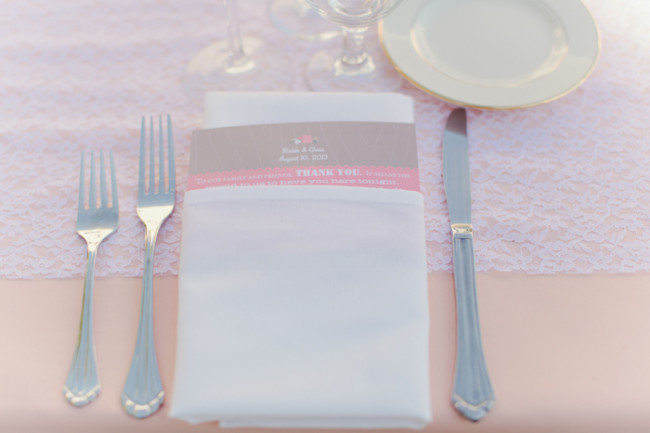 place setting with thank you card on napkin