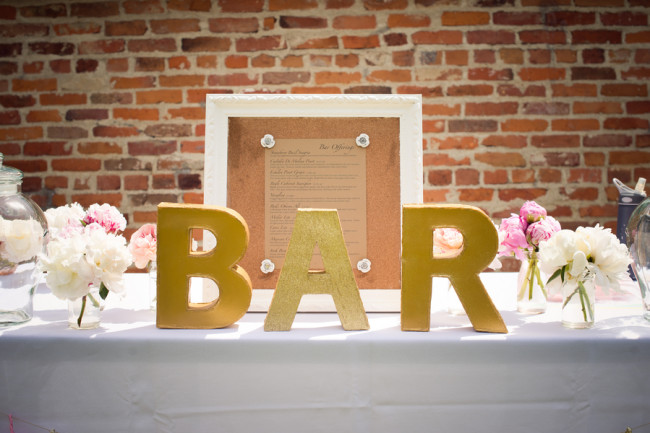 Giant gold letters that say BAR