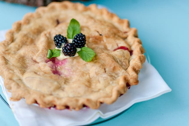 Pie with 3 blackberries on top