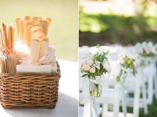 aisle markers: light pink roses in mason jars hang on chairs