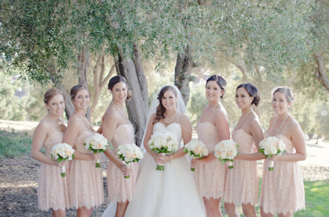 beautiful peach and ivory lace dresses and bouquets