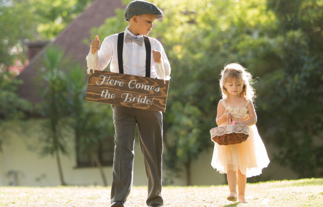 flower girl and ring boy walk together