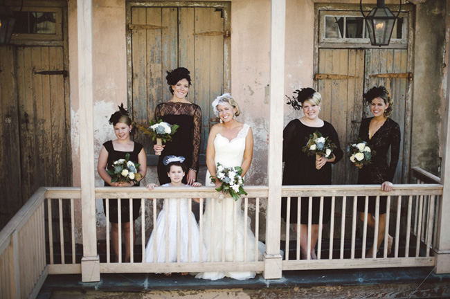 New Orleans Wedding bridal party stands in front of shutters on balcony