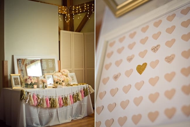 table seating chart with pink and gold hearts