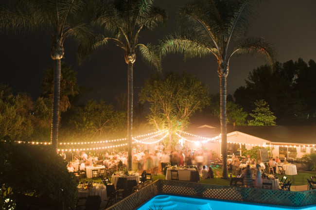 Night time with string lights at backyard wedding in San Diego