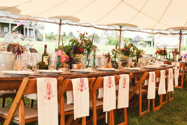reception table with lobster cloth seat backs under open canopy tent