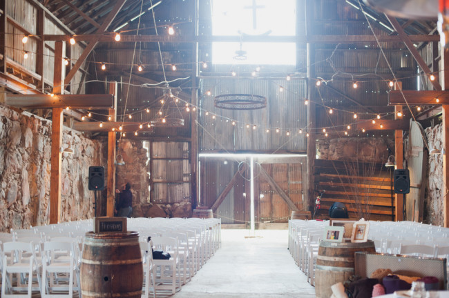indoor wedding ceremony at Santa Margarita Ranch barn