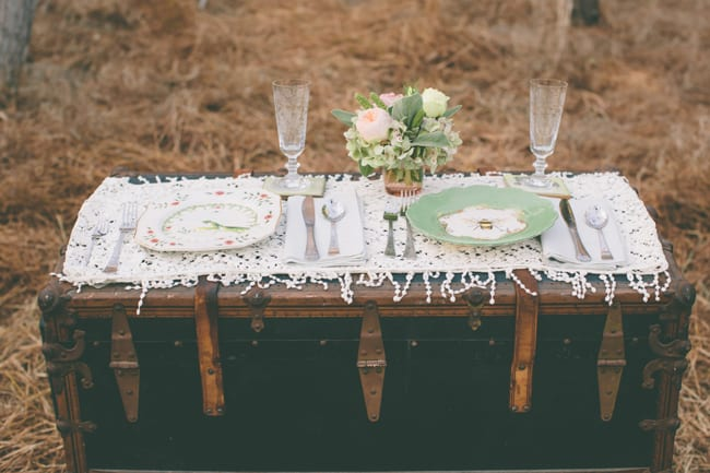 vintage steamer trunk with styled shoot place setting