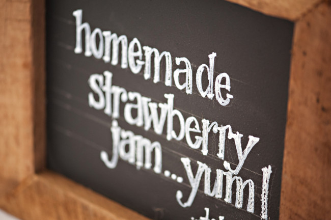 "chalkboard sign that says ""homemade strawberry jam .. yum"""