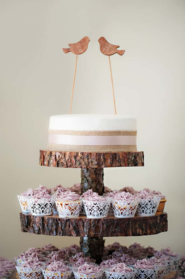 lovebird cake topper with wood rounds and cupcakes