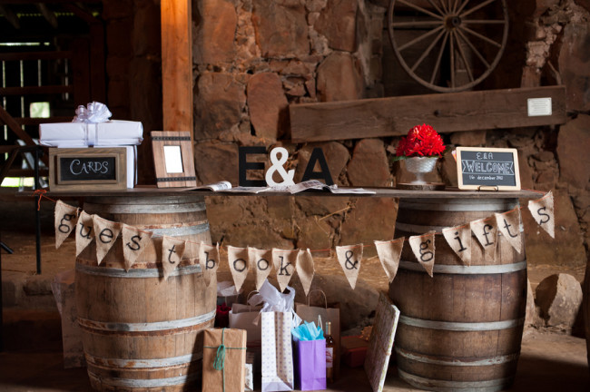 guest book table with bunting banner on two wine barrels