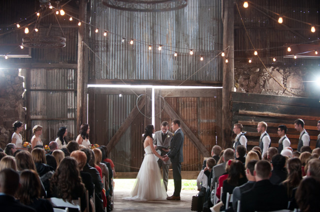 wedding ceremony indoor at Santa Margarita Ranch barn