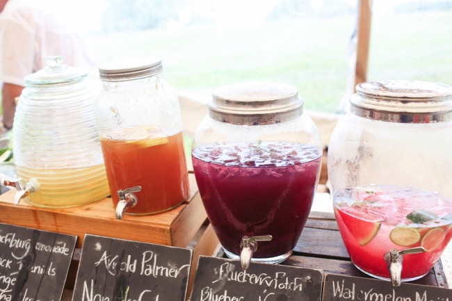 Jugs of lemonade, blueberry, watermelon, and non-alcoholic punch