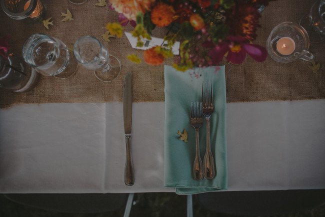 burlap table runner with cutlery and napkin