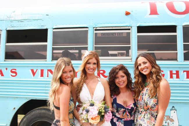 bride and bridesmaids with mismatched dresses in front of old school bus painted aqua