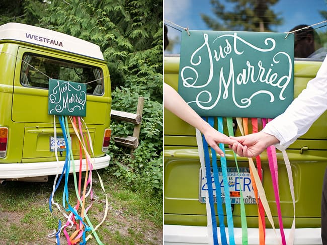 westfalia van with just married sign and colorful streamers