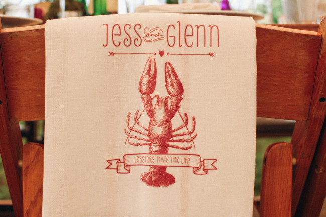 "seatback cloth for wedding reception that says, ""Jess and Glenn, Lobsters mate for life"""