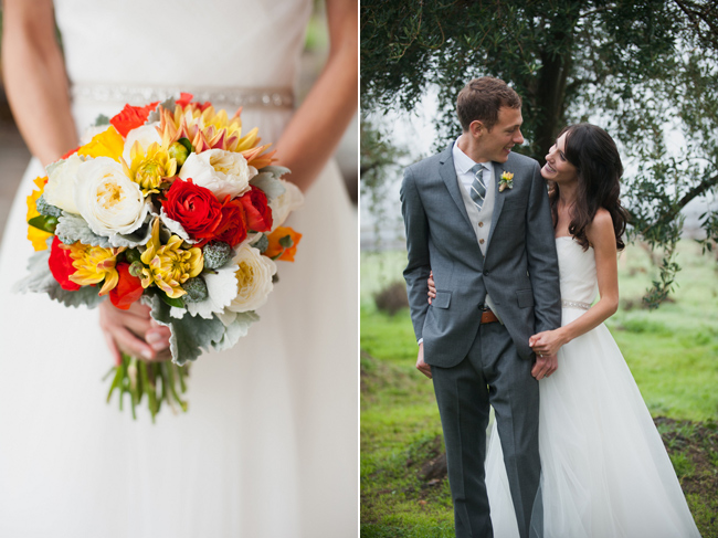 Bride holding red, yellow, and white flower bouquet