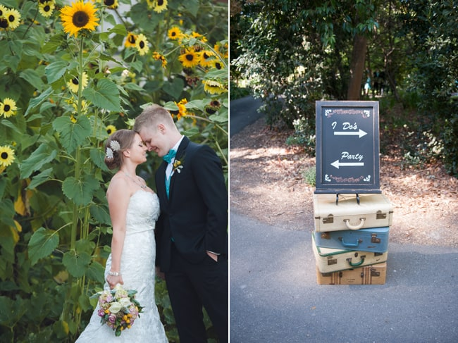 Bride and groom stand next to giant sunflowers; vintage luggage with sign