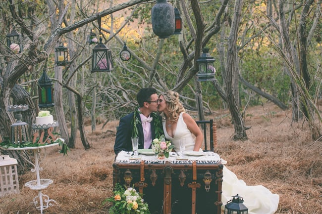 lantern fall wedding styled shoot couple at steamer trunk dining table