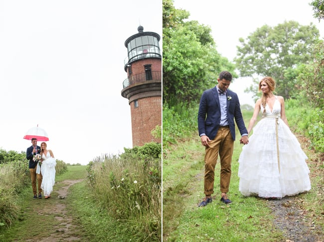 Bride and groom under umbrella walk past Aquinnah Lighthouse